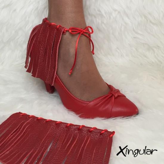flecos piel roja stilettos xingular muestra