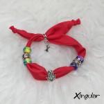 pulsera seda roja stilettos xingular muestra